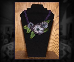 Wool needle felted floral necklace with hand knit cord. Can be made in the colours and lengths of your choice.